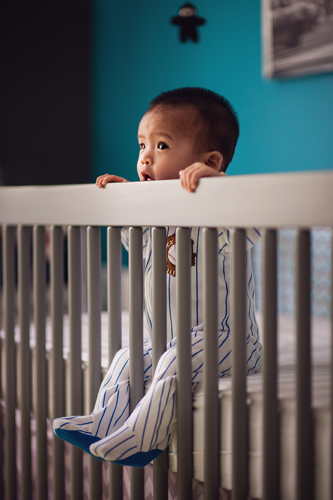 Baby hanging out in crib
