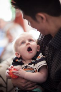 cute baby surprise and shocking expression