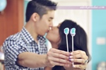 proud parents-to-be holding up cake pops that reveal gender at party - adorkableduo.com