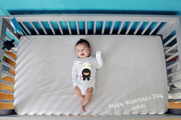 love ninja graphic on plain white baby onesie valentines day greeting