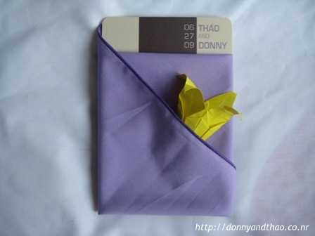 Finished origami lily in napkin, diy wedding menu card
